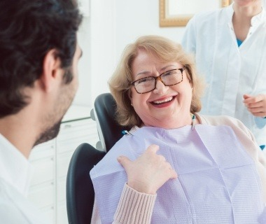 Laughing older woman in dental chair