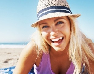 Woman with gorgeous smile on the beach