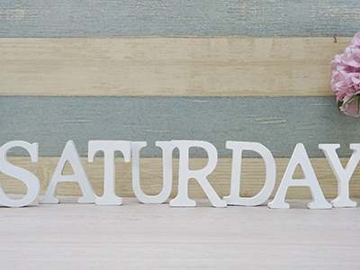 Block letters that spell Saturday on desk