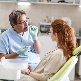 dentist talking to patient consultation